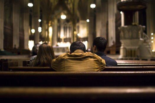 praying people at the church